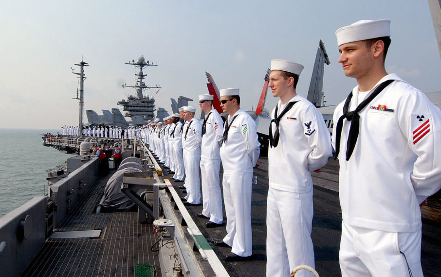 Sailors man the rails aboard the aircraft carrier USS George Washington (Credit: Mass Communication Specialist Seaman Adam K. Thomas)