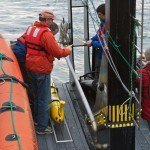 OSU/OOI personnel onboard the R/V Pacific Storm prepare the glider for deployment. (Photo Credit: Craig Hayslip, OSU)