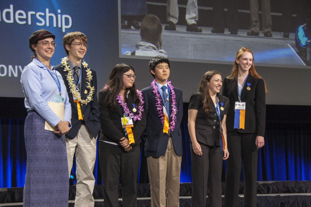 L-R, Sharon Katz Cooper (Consortium for Ocean Leadership) stands with Ocean Science award winners Logan Davis, Erin Main, and Kyle Flores of Honolulu, HI and Arianne Papa and Jane Smyth of Lido Beach, NY at the award ceremony for the Intel International Science and Engineering Fair, in Pittsburgh, PA, on May 17, 2012.
