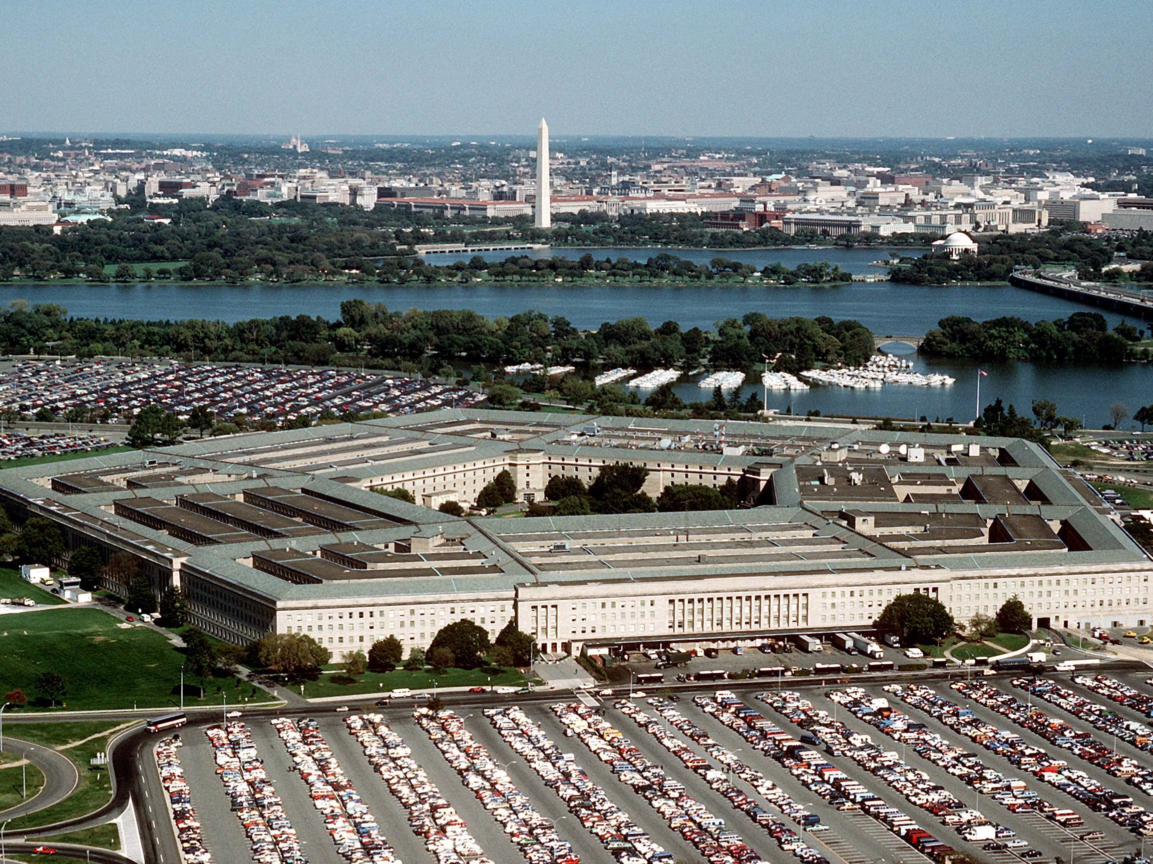 The Pentagon, looking northeast with the Potomac River and Washington Monument in the distance. The Tidal Basin is seen just below the Washington Monument. The marina which is visible is in Pentagon Lagoon, which is part of the Boundary Channel of the Potomac River. Trees border the Boundary Channel and exist both on the Virginia shoreline and on Columbia Island (an island in the Potomac River).
