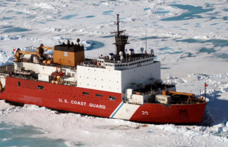 (Click to enlarge) The U.S. Coast Guard Healy Class Icebreaker HEALY sits in the ice, about 100 miles north of Barrow, Alaska, in order to allow scientists onboard to take core samples from the floor of the Arctic Ocean on June 18, 2005. (Credit: U.S. Coast Guard/DoD)